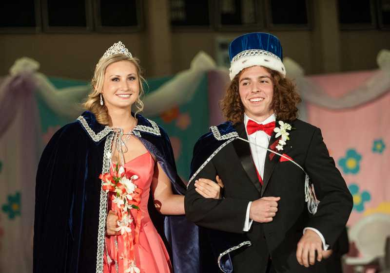 by: SPOKESMAN PHOTO: JOSH KULLA - Wilsonville High School Springfest 2014 Queen Madison Rasmussen and King Andrew Farrington take their honorary walk after being crowned Friday night.