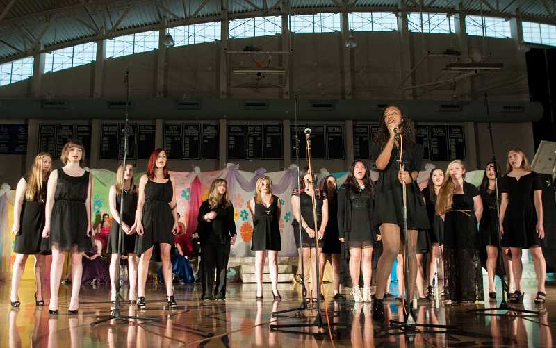 by: SPOKESMAN PHOTO: JOSH KULLA - The Wilsonville High School Concert Choir performs Friday at Springfest.