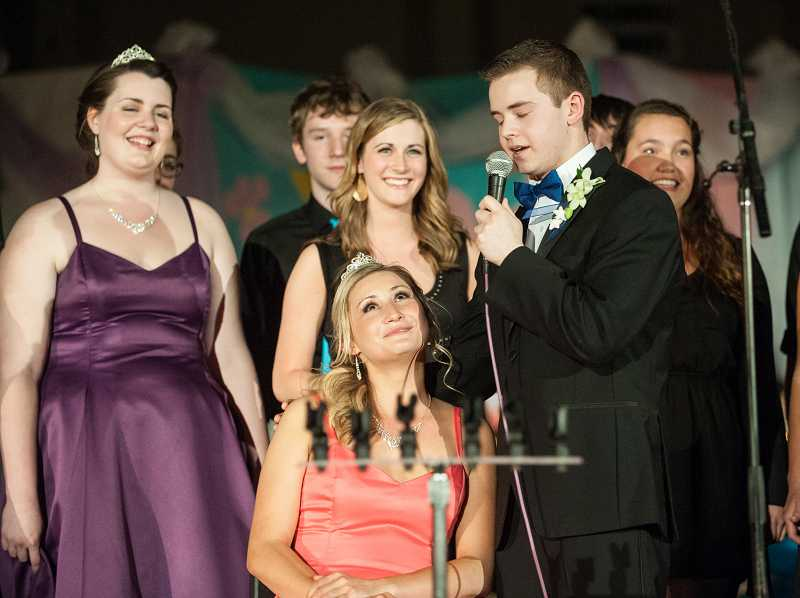 by: SPOKESMAN PHOTO: JOSH KULLA - Prince Jason Kummerman, also a member of Wilsonville High School's a cappella group Soul'd Out, serenades Queen Madison Rasmussen with â'Just Keep Breathing' by We Three Kings.