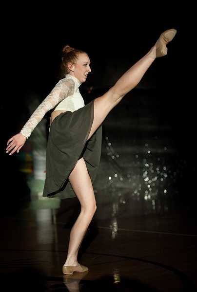 by: SPOKESMAN PHOTO: JOSH KULLA -  Kelsie Kaiser performs a solo dance routine Friday at Springfest 2014 at Wilsonville High School. 'I like performing in front of my classmates,' she said. 'I like showing them what I can do.'