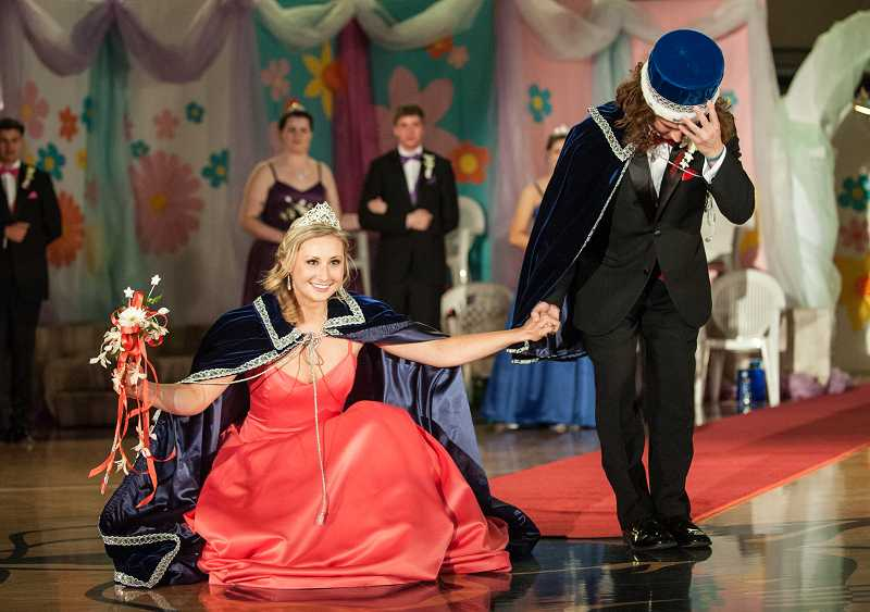 by: SPOKESMAN PHOTO: JOSH KULLA - Queen Madison Rasmussen and King Andrew Farrington bow to the crowd at Springfest 2014, 'Spring Under the Stars,' Friday at Wilsonville High School.