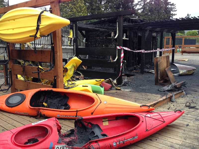 by: SUBMITTED PHOTO: GERT ZOUTENDIJK - Burned and ruined kayaks sit on the deck of Lakewood Bay Community Club. At least 12 kayaks and paddle boats were destroyed by fire early Tuesday morning.