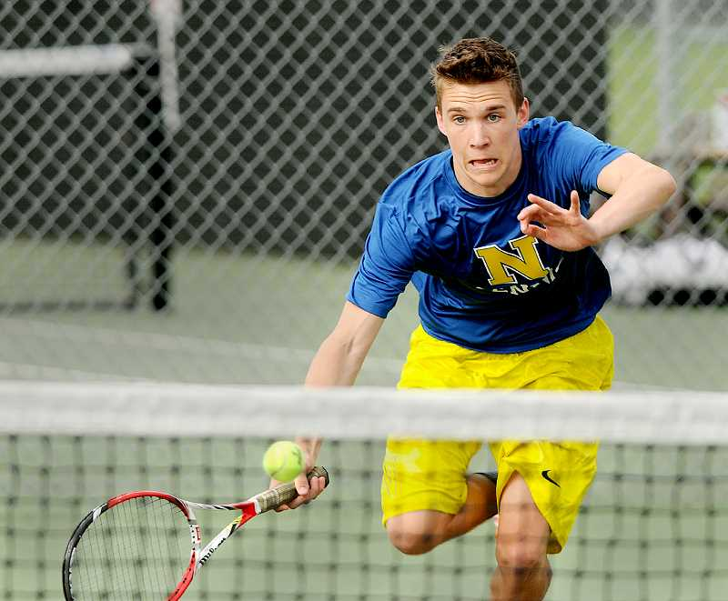 by: SETH GORDON - Stretch - Barry Vernon reaches to play a ball during his No. 1 doubles victory over Forest Grove on April 8. Vernon and partner Micha Stoltzfus are one of the top duos in the Pacific Conference.