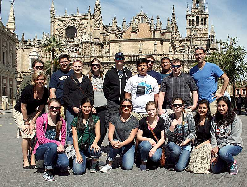 by: SUBMITTED - Soaking up the culture - The group of St. Paul High School students, teachers and chaperones  on a trip to Spain pose in front of the third largest cathedral in the world, located in Seville.