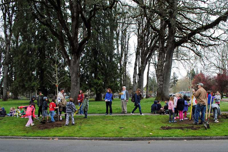 by: NEWS-TIMES PHOTOS: STEPHANIE HAUGEN - For the second year in a row, Forest Grove Community School students gathered at Rogers Park last week to celebrate Arbor Day. Students and staff members have participated in a tree planting each year since 2007.  We encourage students to make positive contributions to their environment and their community, said Vanessa Gray, community school principal.