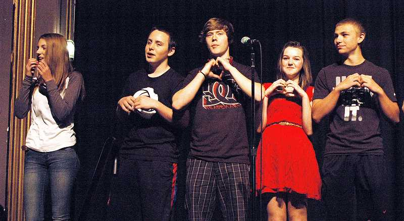 by: ISABEL GAUTSCHI - Eighth-graders Hannah Chandler (from left), Gavin Lawler, Donovan Hamilton, Emma Stamm and Jared Weaver sing their hearts out during a dress rehearsal for the 'From African Rhythms to American Blues' Concert.