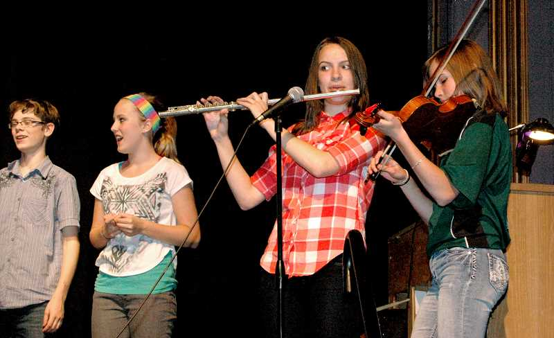 by: ISABEL GAUTSCHI - Chael Skupa(from left), Tessa Liesegang sing along as  Hannah Strobel on flute Lauren Walters on violen provide accompaniment.
