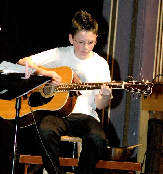 by: ISABEL GAUTSCHI - Seventh-grader Carson Beguelin gets into blues guitar.