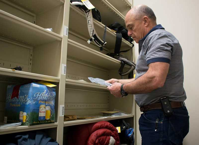 by: RAY HUGHEY - Canby Police evidence technician Don Hemstreet keeps track of items in the department's property unit.