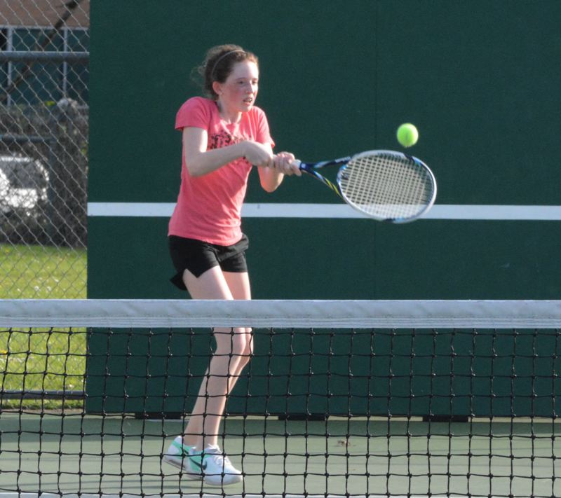 by: TIMES PHOTO: MATT SINGLEDECKER - Sunset's Nicole Partch beat Alohas Vinet Gleva 6-1, 6-1 on Monday to help the Apollos down the Warriors.