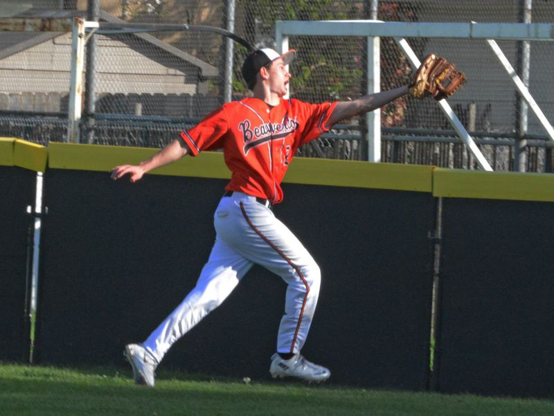 by: TIMES PHOTO: MATT SINGLEDECKER - Beaverton senior rightfielder Drew Kimmer reaches out for a catch in the fourth inning against Reynolds.