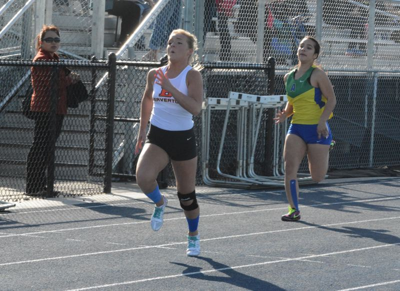 by: TIMES PHOTO: MATT SINGLEDECKER - Beaverton senior Molly Mutz-McCay won the 100-meter dash on Wednesday, just 10 months after tearing her ACL during a powder puff football game.