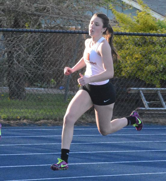 by: TIMES PHOTO: MATT SINGLEDECKER - Beaverton's Lexus Miller-Moylan cruised to victories in the 200 and 400 against Aloha on Wednesday.