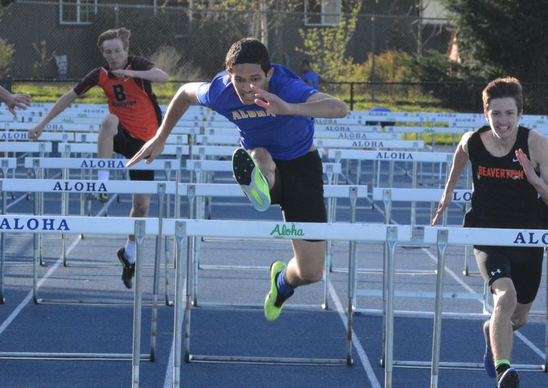 by: TIMES PHOTO: MATT SINGLEDECKER - Aloha's Tongia Taufoou won the 110-meter and 300-meter hurdles against Beaverton last week.