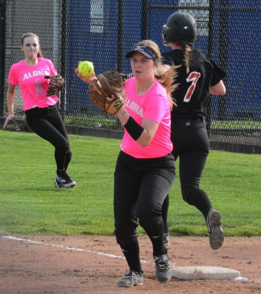 by: TIMES PHOTO: MATT SINGLEDECKER - Aloha second baseman Emily Powers looks back a runner to third after getting an out versus McMinnville.