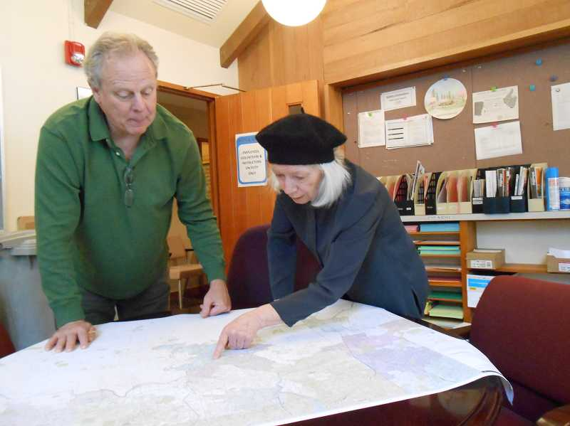 by: REVIEW PHOTO: CLIFF NEWELL - Tom Brennan and Ronnie Bennett go over maps of Lake Oswego as they plan to establish a senior self-help village here named Three Rivers Village.