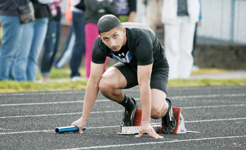 by: PHIL HAWKINS - Woodburn junior Nate Bosquez took first place in the 100-meters and the long jump Wednesday against Dallas and was a part of the Bulldogs first-place 4x100 and 4x400 relay teams.