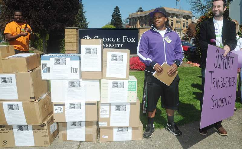 by: GARY ALLEN - Support - Jayce (center) stands with his attorney, Paul Southwick, and besides the thousands of signatures submitted encouraging George Fox University to reconsider banning Jayce from rooming on campus with male friends.