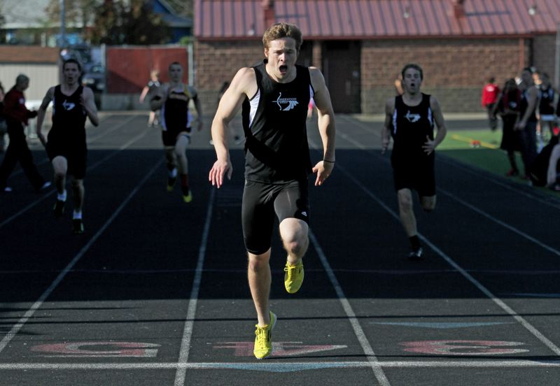 by: JONATHAN HOUSE  - THE VICTOR -- Sherwood senior Cole Nixon lets out a yell as he crosses the finish line in the 400-meter dash.