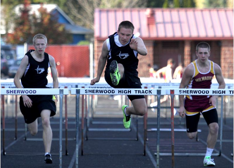by: JONATHAN HOUSE  - UP AND OVER -- Sherwood's Tyler Thayer was in winning form in the 110-meter high hurdles.