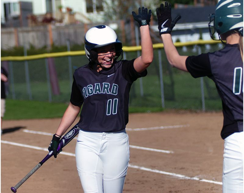 by: DAN BROOD - WAY TO GO -- Tigard senior Liz Vanderburg (left) is congratulated by Tiger junior Alexa Hansen after scoring a second-inning run in the team's 8-- victory at Milwaukie last Thursday.