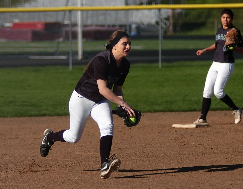 by: DAN BROOD - FOR THE DEFENSE -- Tigard sophomore shortstop Dena Emmons fields a grounder in the Tigers' win at Milwaukie.