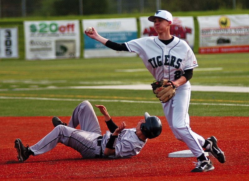 by: DAN BROOD - RASOR'S EDGE -- Tigard senior shortstop Shane Rasor (right) makes a throw to first base after forcing out Glencoe's Grant Ramey at second base in Friday's Pacific Conference game.