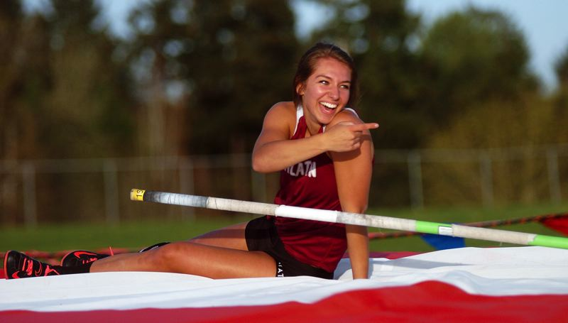 by: DAN BROOD - ALL SMILES -- Tualatin senior Laura Taylor smiles bright following her final attempt at 12-6.