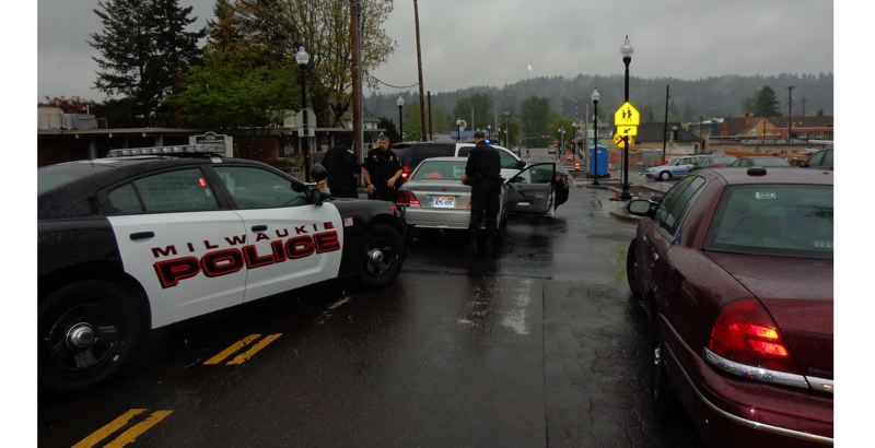 by: PHOTO COURTESY: MPD - Officers box-in the suspects near Washington Street and 23rd Avenue in downtown Milwaukie.