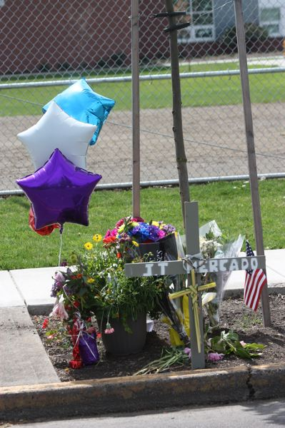 by: HILLSBORO TRIBUNE PHOTO: DOUG BURKHARDT - A makeshift memorial stands on 18th Avenue in Forest Grove, where J.T. Mercado-Nuno was struck by an SUV and killed April 9 as he was helping to unload a lawnmower from a truck.
