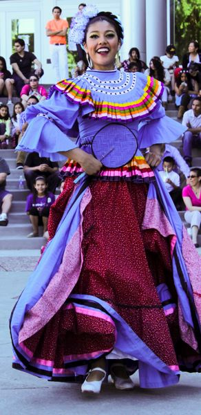 by: HILLSBORO TRIBUNE PHOTO: JOHN SCHRAG - Performer with the Forest Grove-based Ballet Mexico en la Piel dazzled the crowd in the plaza with traditional Mexican dance moves.