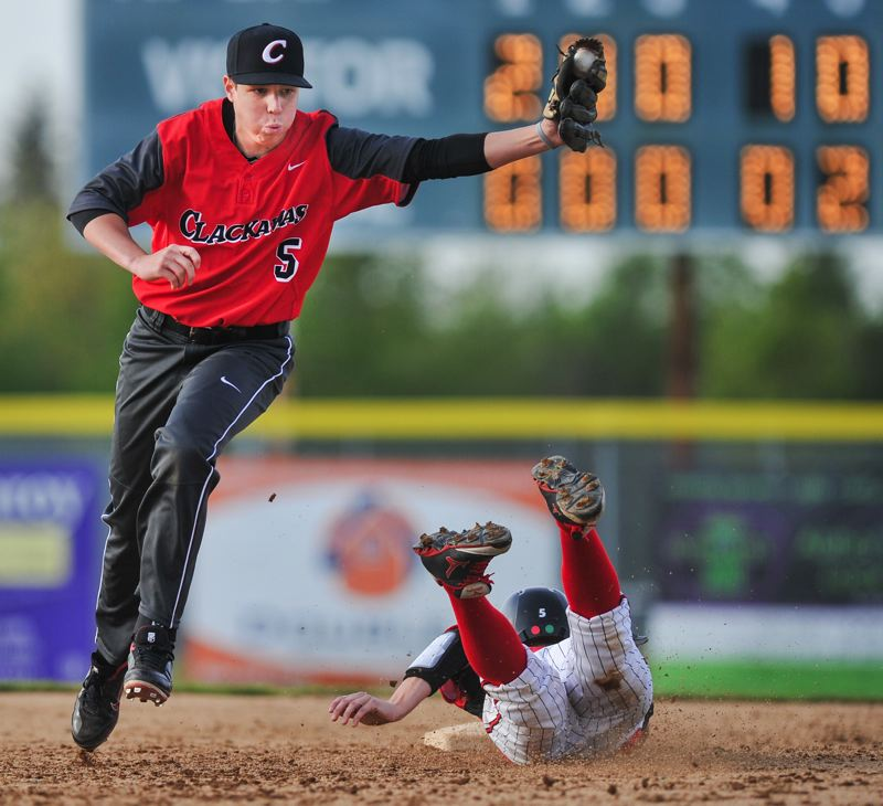 by: JOHN LARIVIERE - Clackamas second baseball Danny Houf celebrates a huge inning-ending double play in fifth inning of Fridays 4-3 win over Oregon City. Oregon City had the bases loaded with one out when Aaron Ahlstrom snagged a line drive at shortstop and tossed the ball to Houf covering second base in time to catch Jalen Satter off the bag for the third out of the inning.