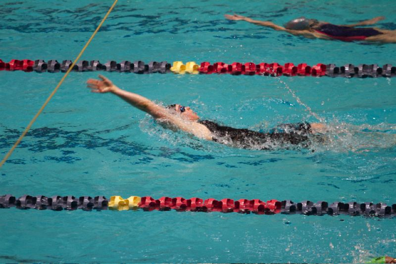 by: SUBMITTED - Oregon Citys Kate Laderoute heads for a state record in the 200-backstroke at the Northwest Age-Group Regionals.