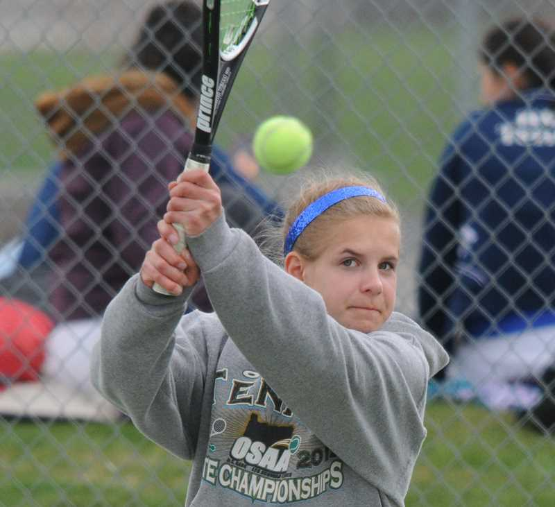 by: LON AUSTIN/CENTRAL OREGONIAN  - Greta Harris plays a backhand winner during the Madras Invitational Tournament. Harris finished first in the No. 2 singles division at the tournament.