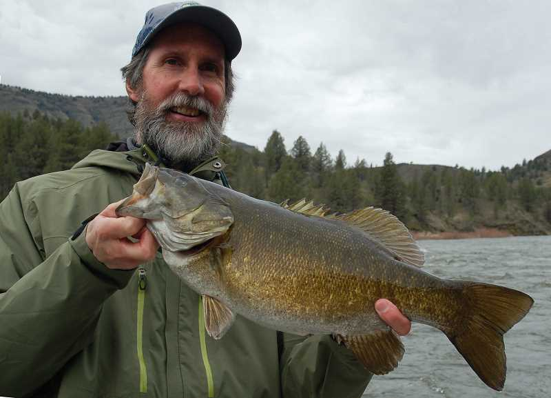 by: SCOTT STAATS SPECIAL TO THE CENTRAL OREGONIAN - The author with a 20-inch bass.