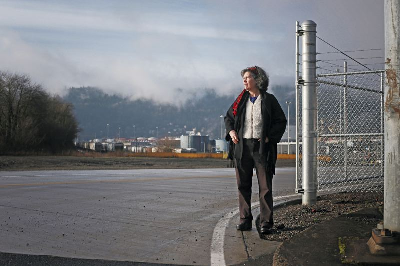 by: PAMPLIN MEDIA GROUP: JONATHAN HOUSE - St. Johns activist Barbara Quinn, outside the Port of Portlands Terminal 4, is opposed to plans to dispose dredged material from the Portland Harbor in containment facilities near her neighborhood along the Columbia River.