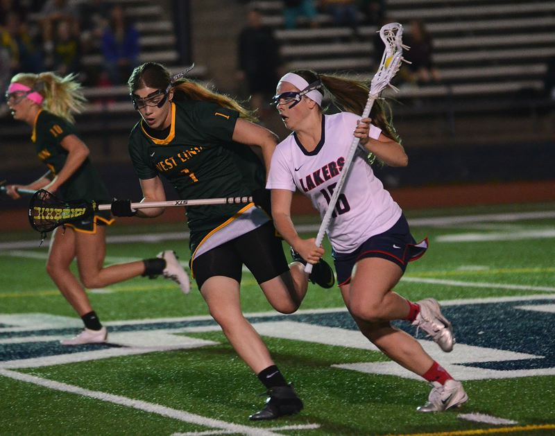 by: VERN UYETAKE - Lake Oswego's Lilly Newman scored four goals for the Lakers in its game agianst West Linn Monday. Lake Oswego rallied back from a 10-4 halftime deficit but couldn't complete the comeback.