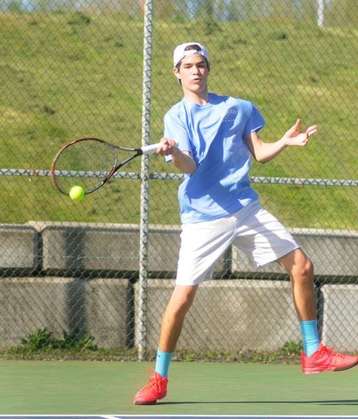 by: MATTHEW SHERMAN - Simone Homedes returns a shot in his straight sets victory against Lake Oswego last week. Homedes is playing No. 1 singles for Lakeridge this year.