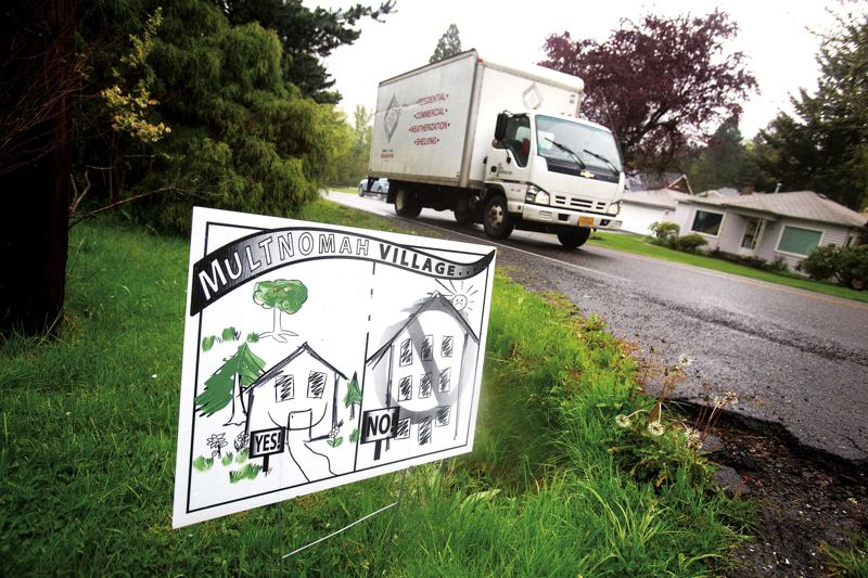 by: TRIBUNE PHOTO BY JONATHAN HOUSE - An anti-large house sign sits near a Renaissance Homes infill project in Southwest Portland.