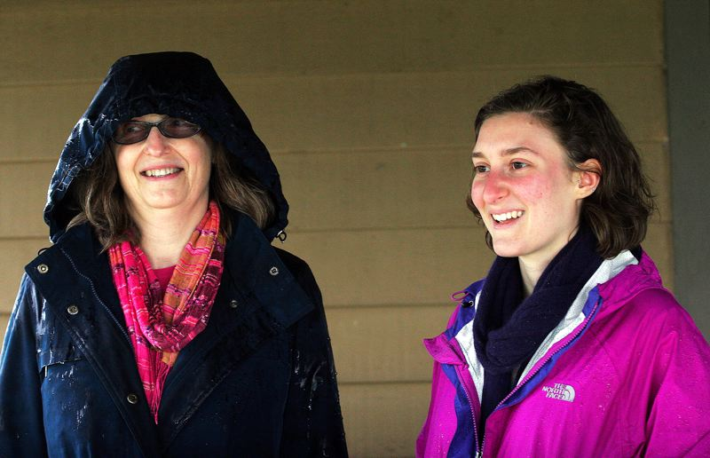 by: OUTLOOK PHOTO: JIM CLARK - Jenny Holmes, left, and Katrina Haller of Ecumenical Ministries of Oregon talk about ways a community garden is beneficial.