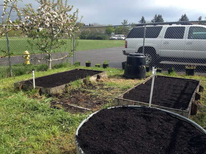 by: COURTESY PHOTO: KIMBERLY MARTIN - After a full days work, the raised beds were ready for their Earth Day planting.