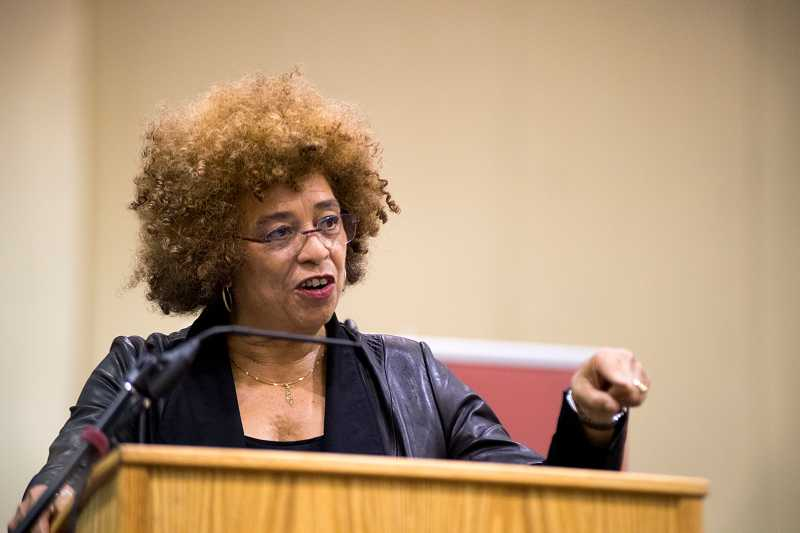 by: NEWS-TIMES PHOTO: CHASE ALLGOOD - Angela Davis, a 1960s civil rights activist-turned-author and lecturer, spoke at Pacific University Friday. She reminded the audience the 50th anniversary of the Mississippi Freedom Summer is coming in June.