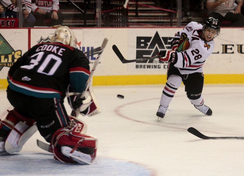 by: TRIBUNE PHOTO: JONATHAN HOUSE - Brendan Leipsic of the Portland Winterhawks fires a shot on goal.