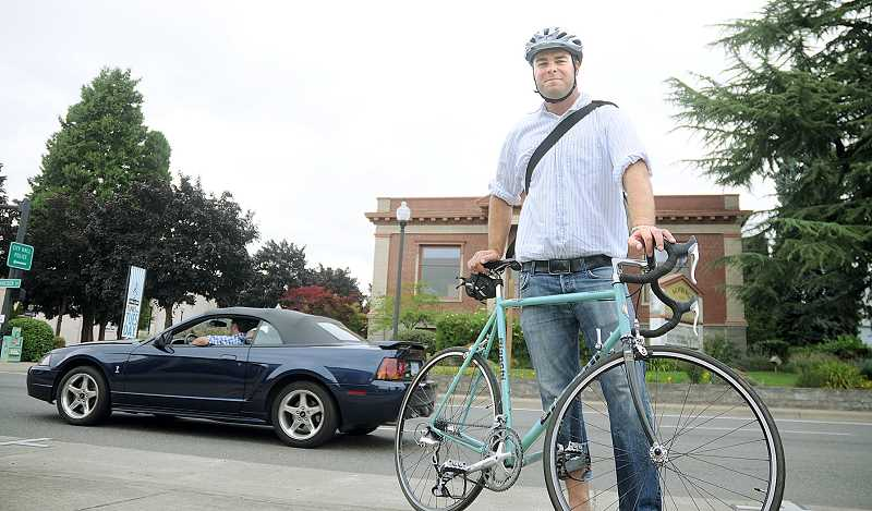 by: FILE PHOTO - Alternate transportation - Newberg City Council member Ryan Howard is an advocate for alternative transportation, including biking. To encourage others to try the same, he and Planner Jessica Pelz have held the May Commute Challenge two years running. The program will continue this year.