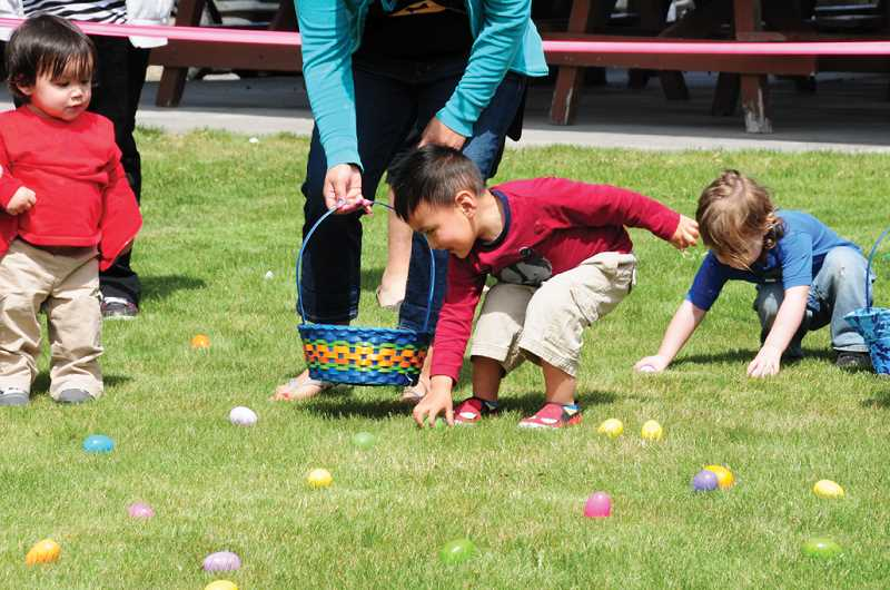 by: BILL VOLLMER/MADRAS PIONEER - Tots gather eggs at the Metolius Easter Egg hunt on Saturday.
