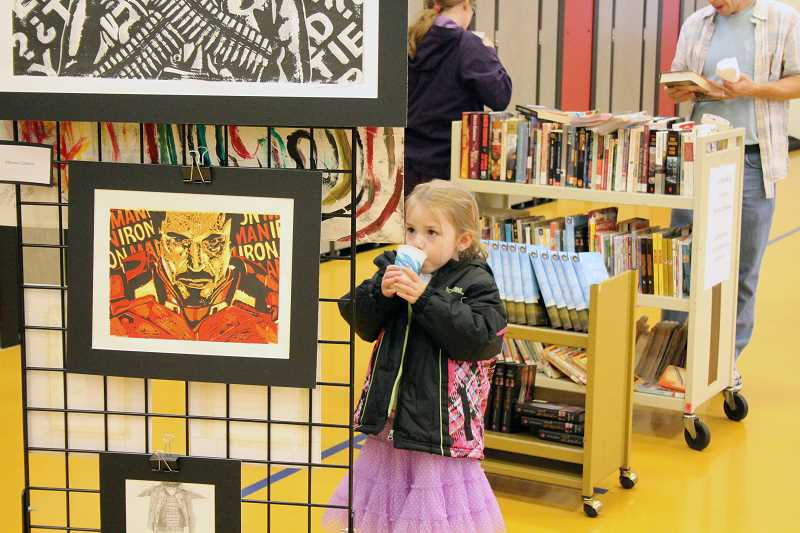 by: TYLER FRANCKE - Kitaya Haneberg, 5, admires a piece of art.