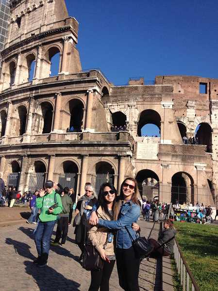 by: SUBMITTED - Amy Gonzalez and Hannah Kloft pose in front of the Coliseum in Rome during a spring break trip provided through John F. Kennedy High School social studies teacher Jessica Schmidtman.