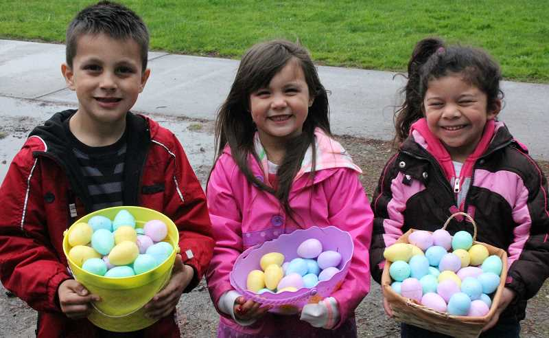 by: TYLER FRANCKE - Anthony Garcia, 5, Amelia Garcia, 4, and Mercedes Mendoza, 4, are egg-static about their haul.