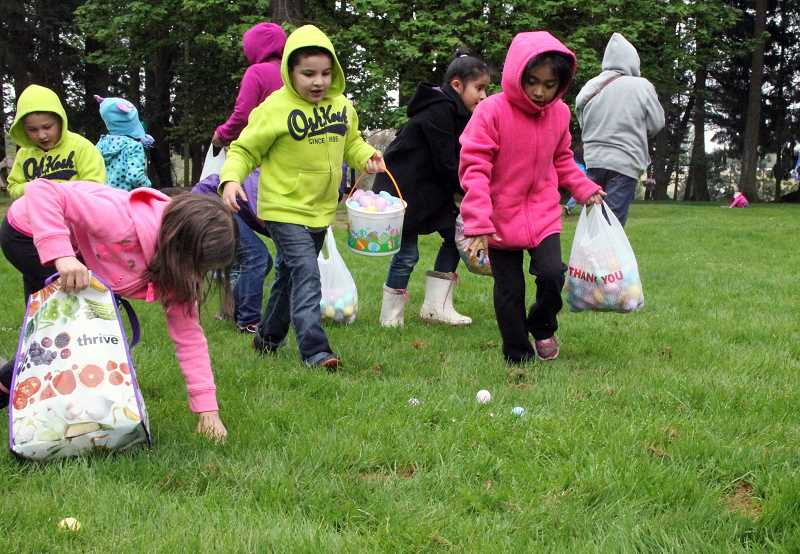 by: TYLER FRANCKE - Children scramble through Legion Park to collect Easter eggs full of goodies.