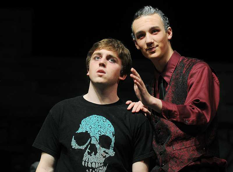 by: SETH GORDON - Family rivalry - Playing Hamlet and Claudius, John Miller (left) and Matthew Jones, rehearse Friday for the Newberg High School Players' upcoming presentation of Shakespeare's 'Hamlet,' which will hit the stage at 7 p.m. Thursday, Friday and Saturday. The troupe will also perform the classic tragedy May 1-3.